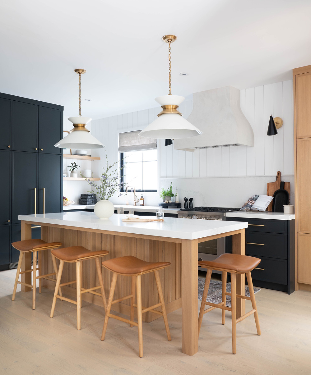 Custom cabinetry throughout the kitchen disguises appliances and adds a personalized functionality to the space. Utilizing every space possible and maintaining ease of movement throughout the kitchen meant thoughtfully designing customized storage solutions.