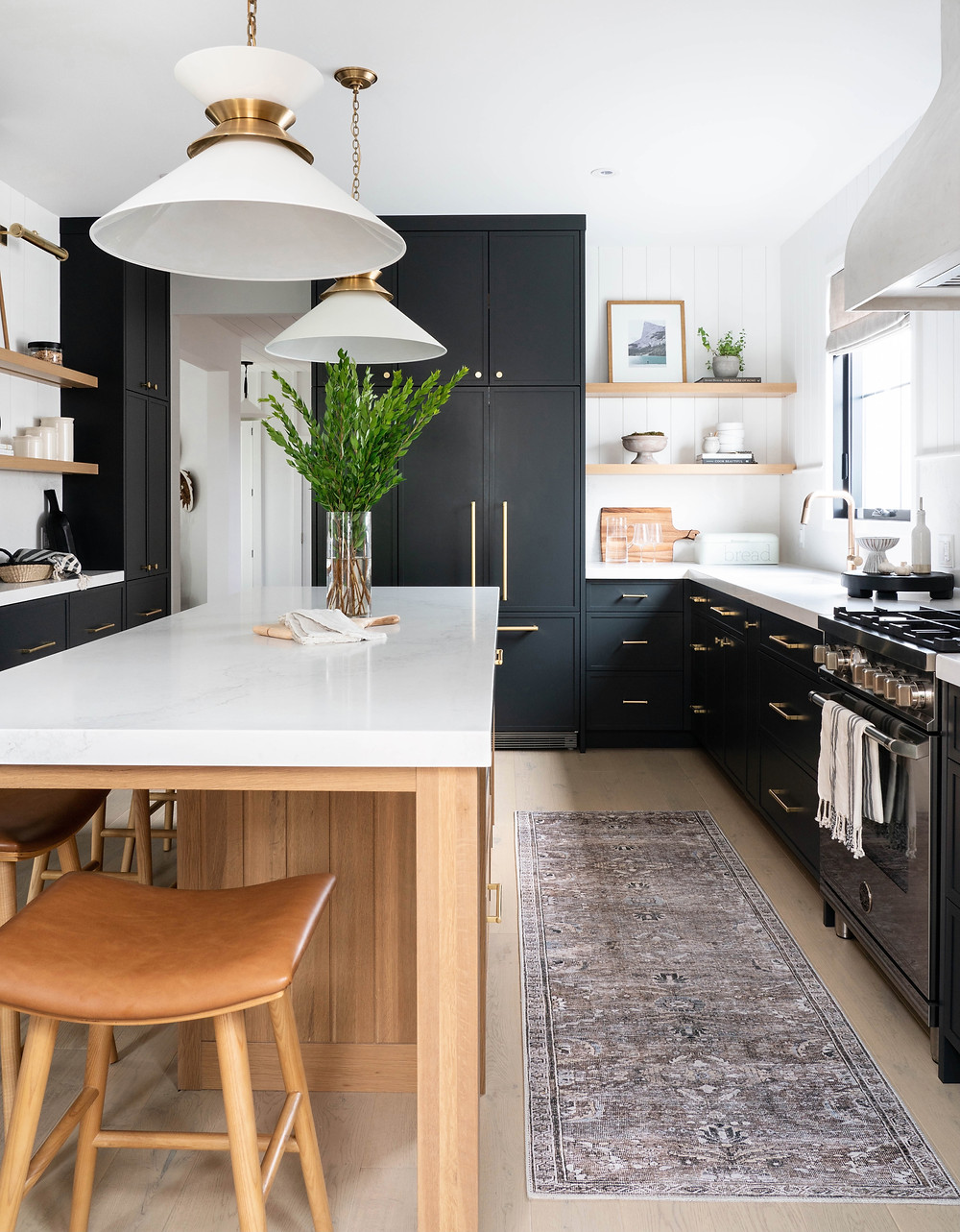 High-contrast kitchen with black thin shaker style cabinets and white oak island design.
