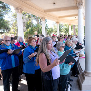"""More than twenty local choirs, including the Poway Community Choir, sing """"America the Beautiful"""" and """"Homeland"""""""