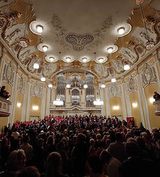 Massed international choirs performing in the beautiful Mozarteum at the International Cantus Music and Culture Festival