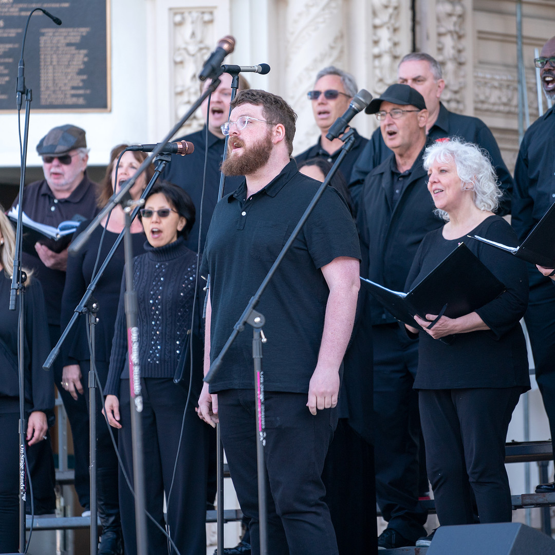 "Soloist Brian Stoops sings during the Poway Community Choir's performance of ""Tshotsholoza"""