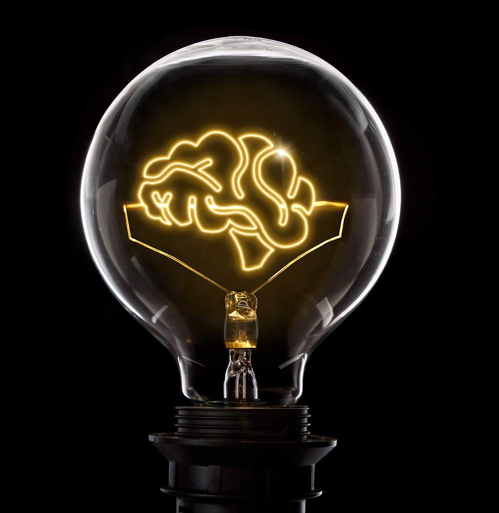 Lightbulb with lit up brain. Chiropractic Adjustment Dr Nathan Jenner Chiropractor Prahran Windsor Melbourne