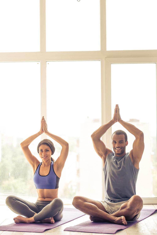Healthy Couple Exercising Yoga Pose Chiropractic Dr Nathan Jenner Prahran Windsor 3181 Melbourne