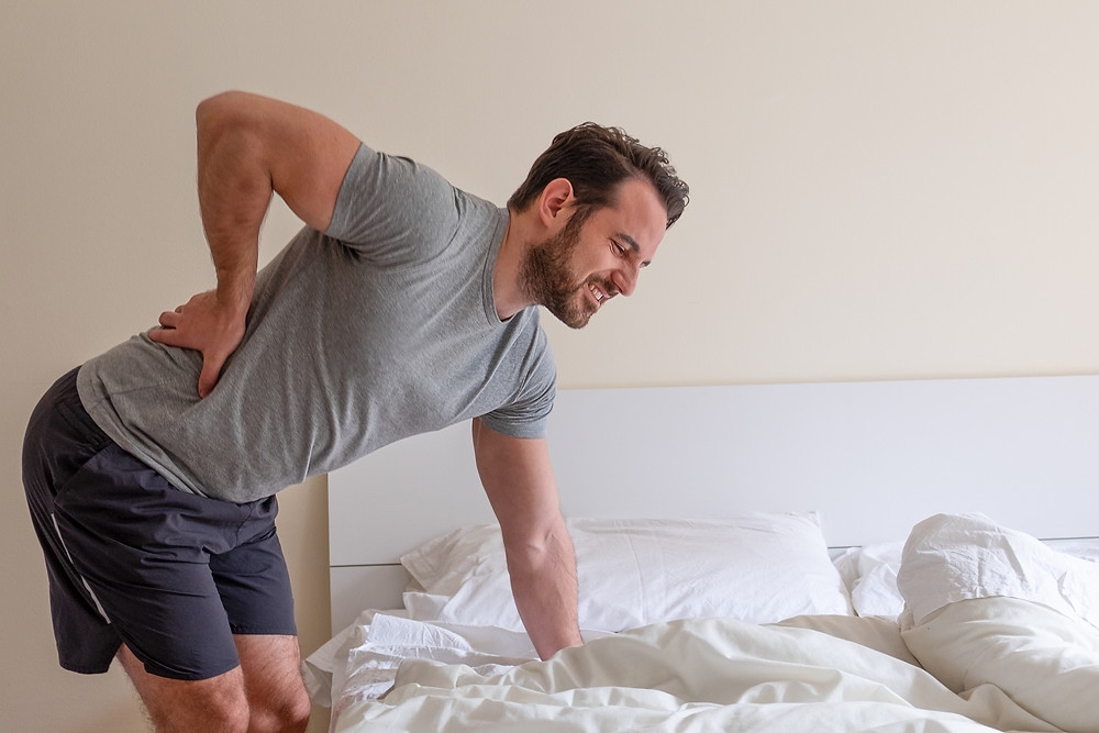 Man with Low Back Pain Sciatica Chiropractic Dr Nathan's Chiropractic Studio Prahran | Windsor Melbourne
