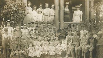 Children and staff outside the Gilpin Moore Home in Rock Island, Illinois, circa 1900.