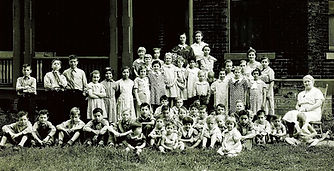Children and matrons at the Gilpin Moore House in Rock Island, Illinois.