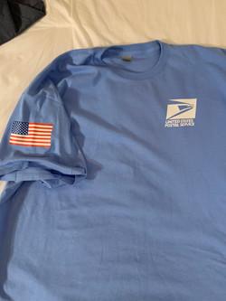 carolina blue post office tee shirt with