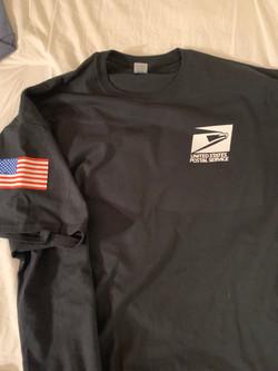 black tee shirt post office white logo.j
