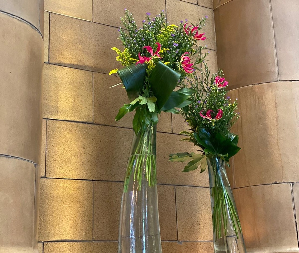 tall flowers in vases at kimpton clocktower hotel manchester