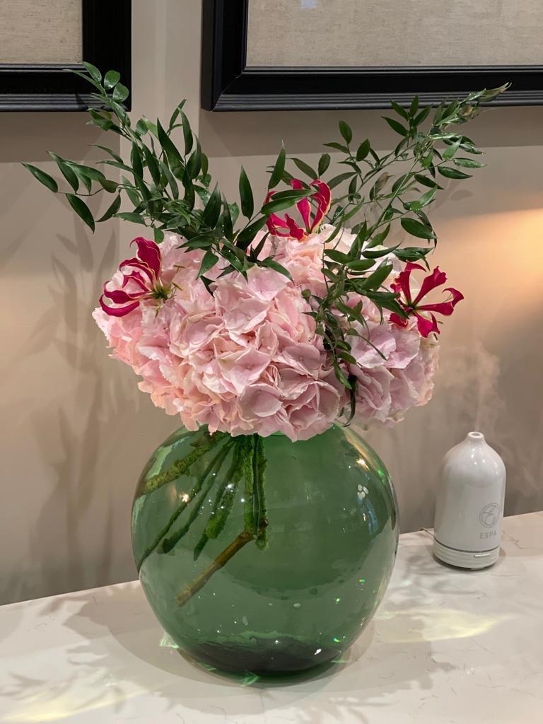 Pink flower in a vase at Manchester based hotel