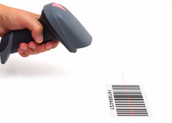 Woman Hold Scanner And Scan Barcode With Laser_edited.jpg