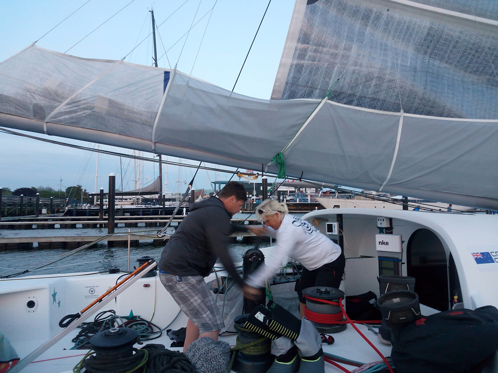 Our Canadian friends hoisting the main, thanks Diane and Andrew © Conrad Colman Ocean Racing