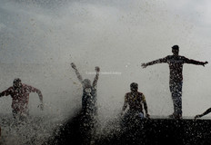 Boys enjoy high-tide