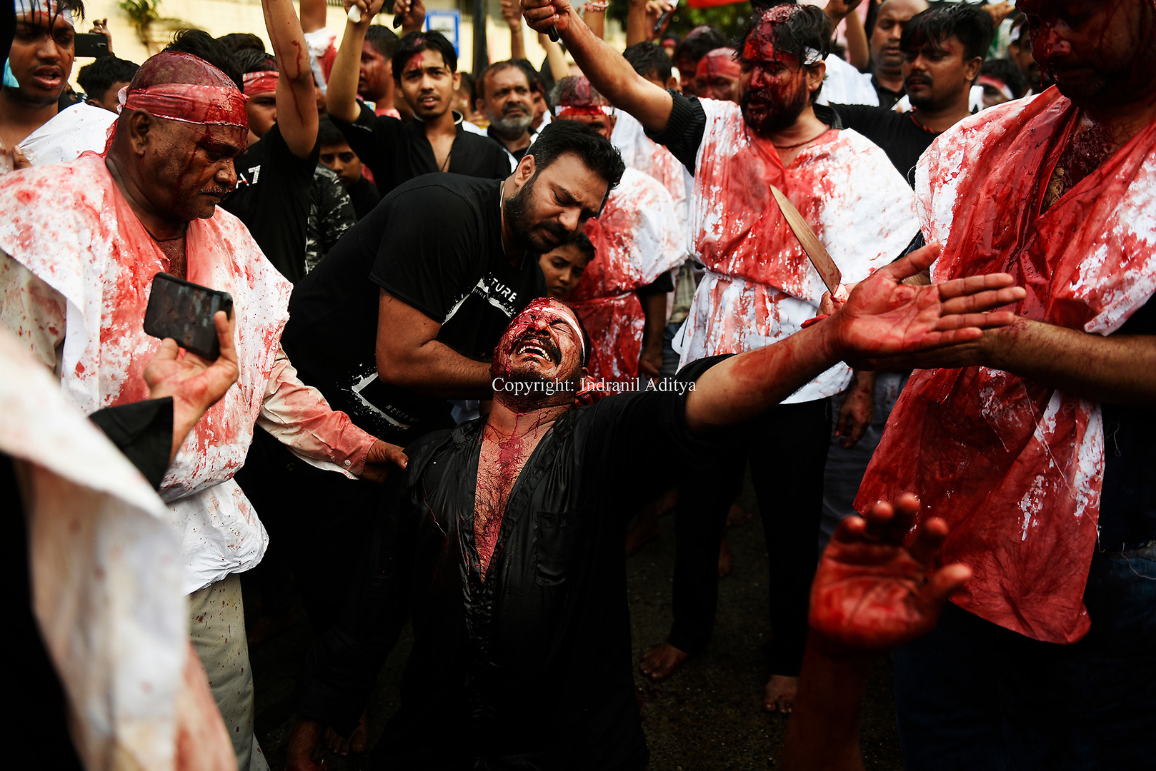 A man mourns during Muharram procession
