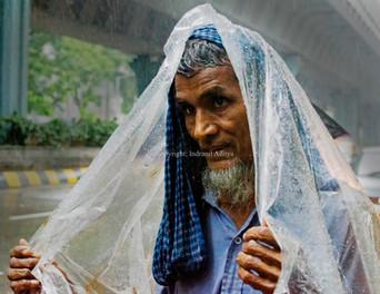 A man holds a plastic sheet
