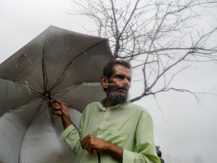 A man holds an umbrella