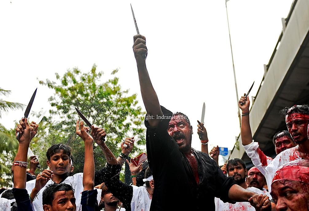 A man flagellates himself during Muharram