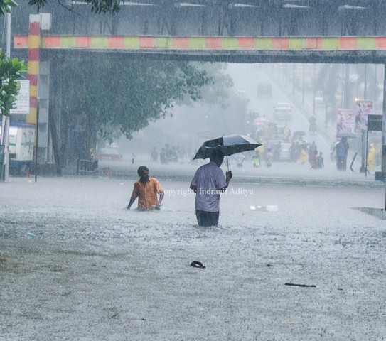 People waded through the water logged streets
