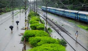 People walks through the railway tracks