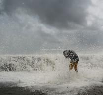 A boy enjoys high tide