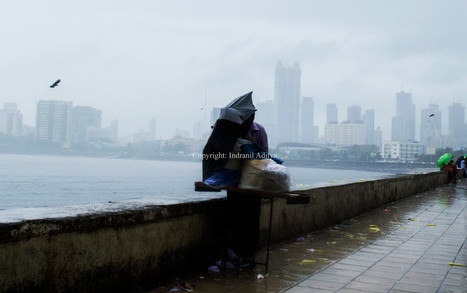 A man protects himself from heavy rain