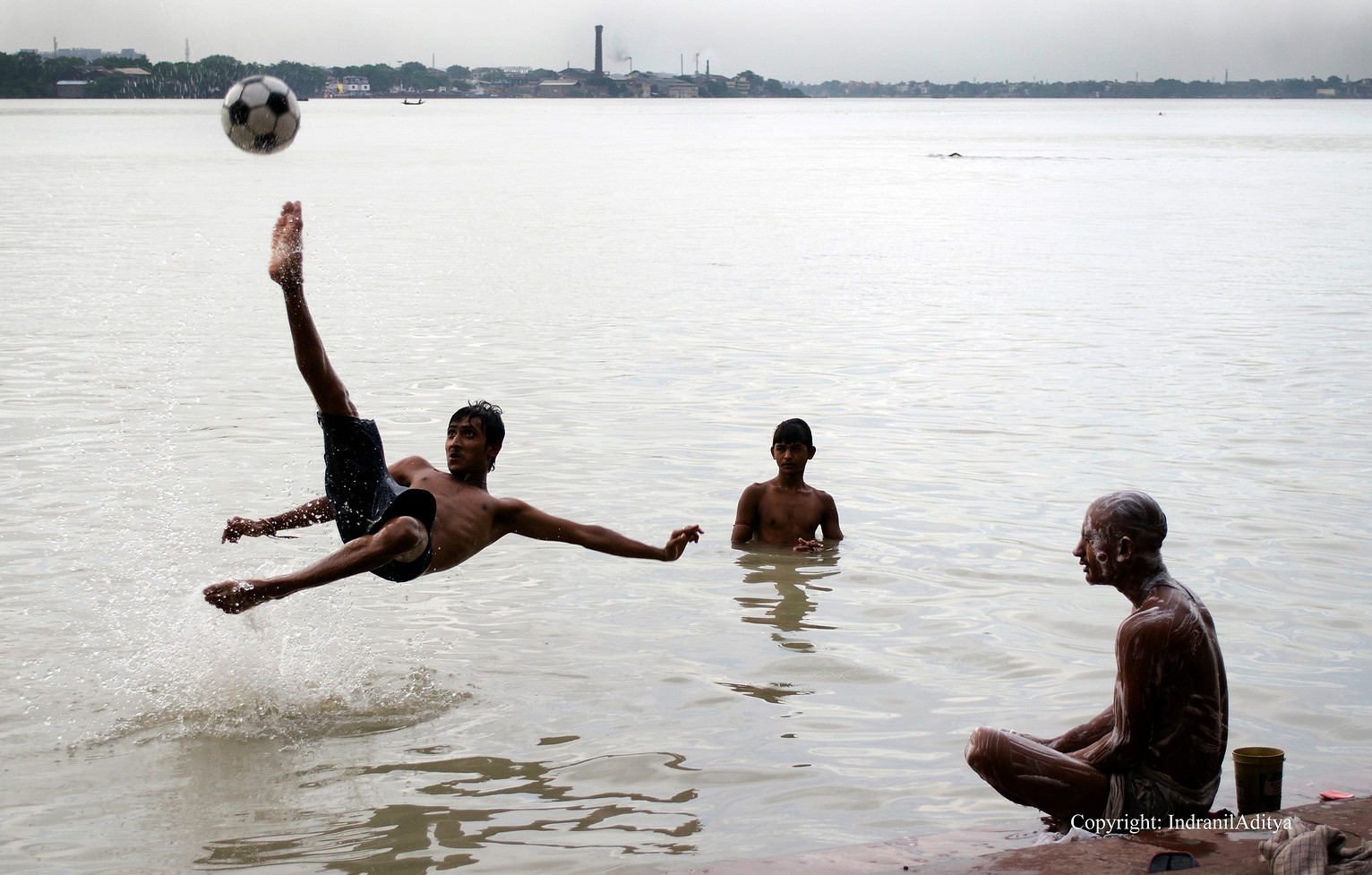 A boy plays back volley