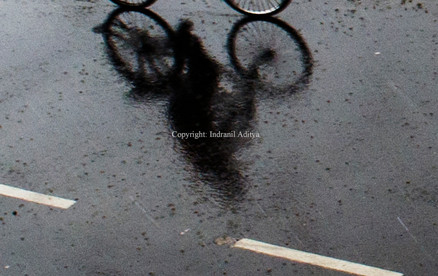 Reflection of a cyclist
