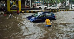 A car waded through a flooded street