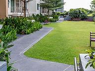 sidewalk through greenspace of community