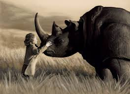 girl talking to rhinoceros