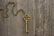 antique golden key over dirty vintage wo