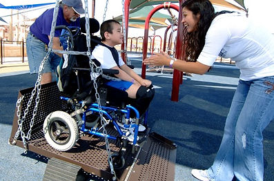 Child in wheelchair swing