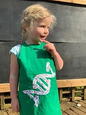 Elfie in Rosalind Franklin DNA apron.jpg