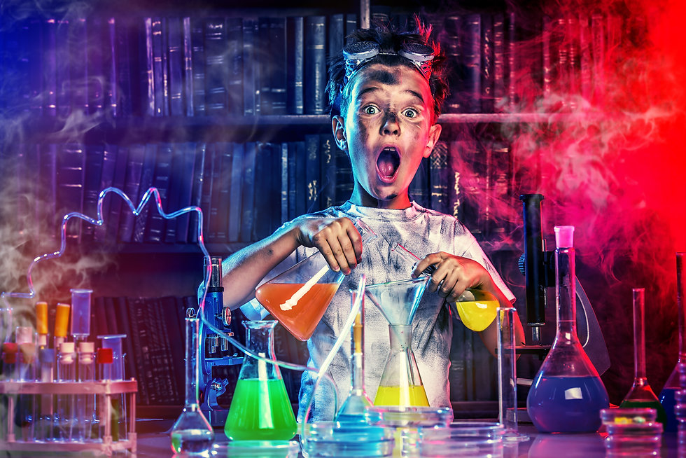 A boy doing experiments in the laborator
