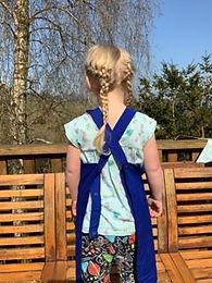 Back of Elfie in blue apron.jpg