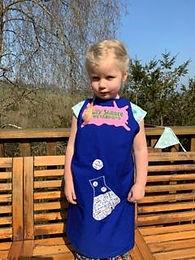 Elfie in blue apron .jpg