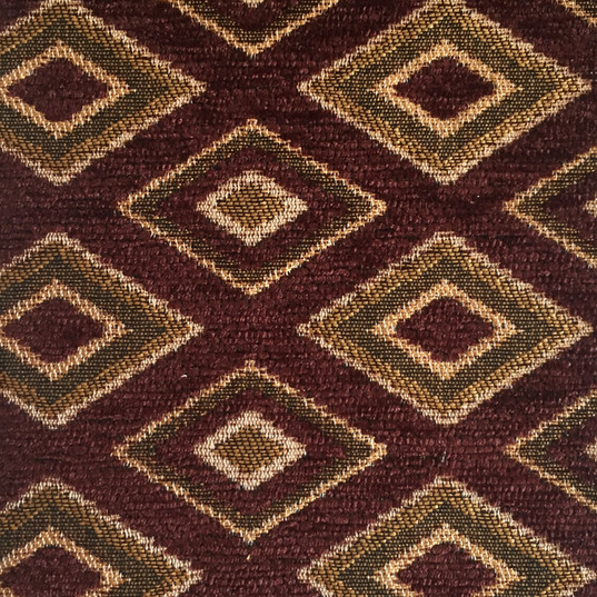 "Genesis Burgundy ·100% Polyester ·54"" ·15,000 Double Rubs ·Repeat: H: 1.75"" x V: 3"" ·Cleaning Code: S ·Railroaded ·Uses: Upholstery"