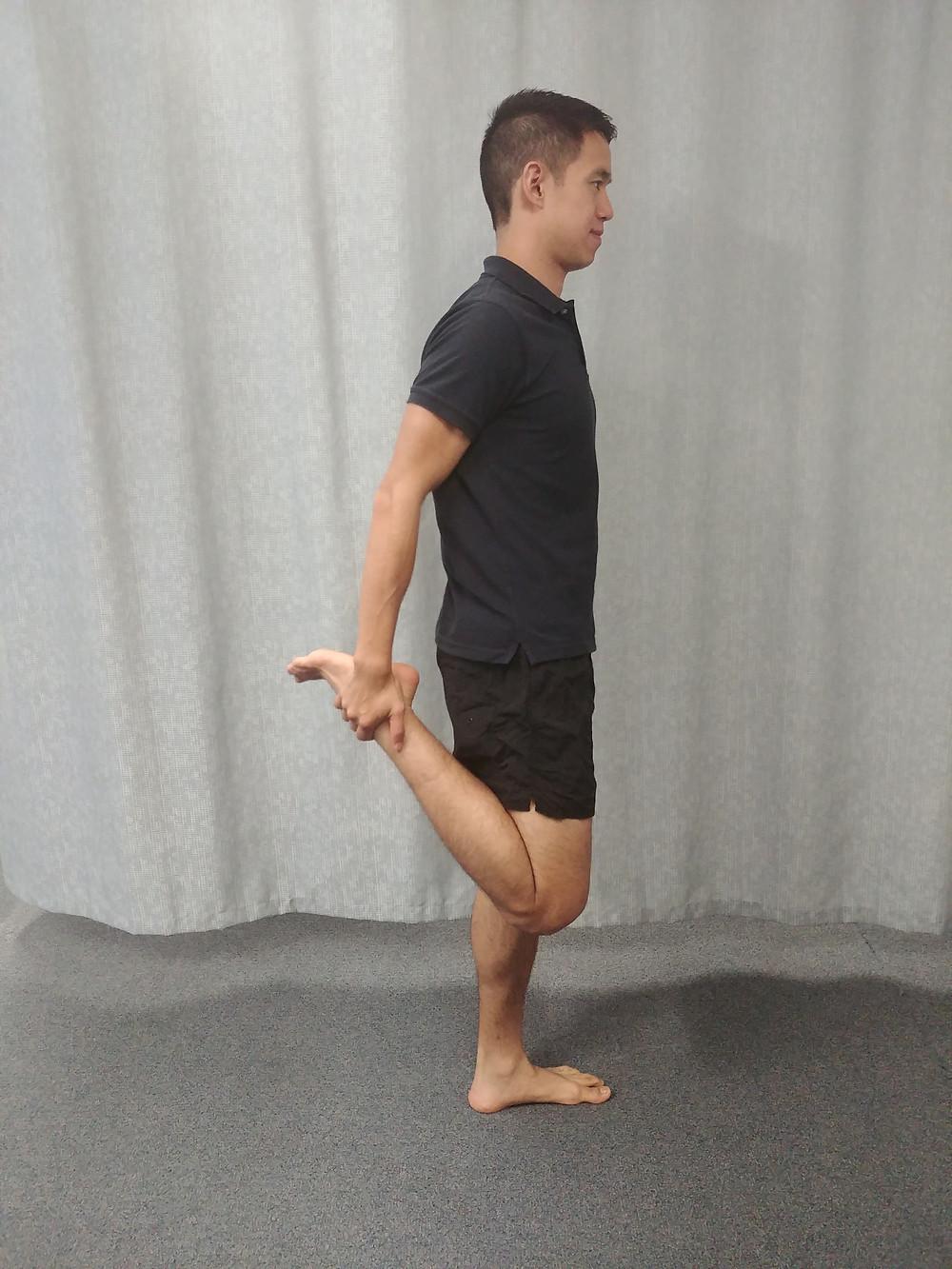 Standing quadriceps stretch for Osgood Schlatter's Disease