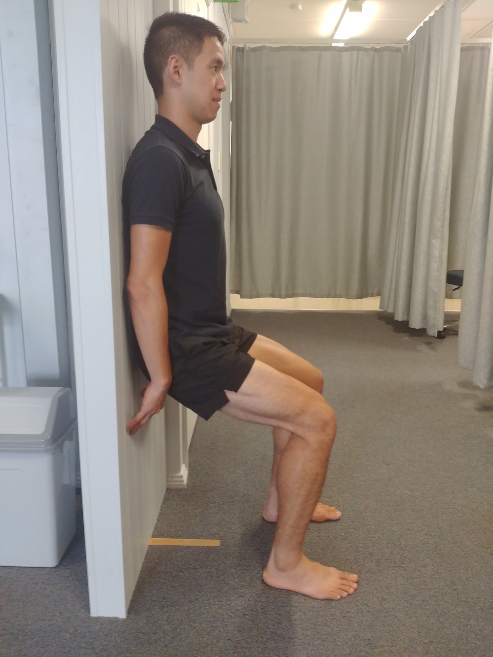 Isometric wall squat for Osgood Schlatter's Disease