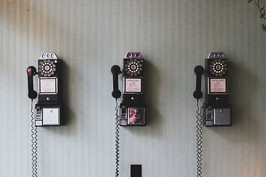 Canva - Vintage Telephones on a Wall.jpg