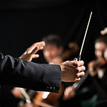 Orkester dirigent på scenen
