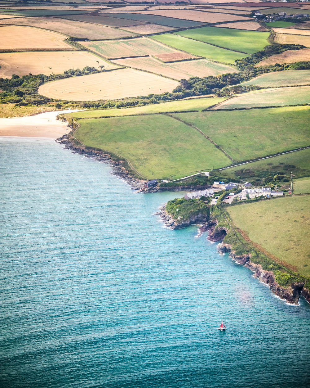 Aerial View Of Hawkers Cove and Tregirls Beach, Cornwall From The Air