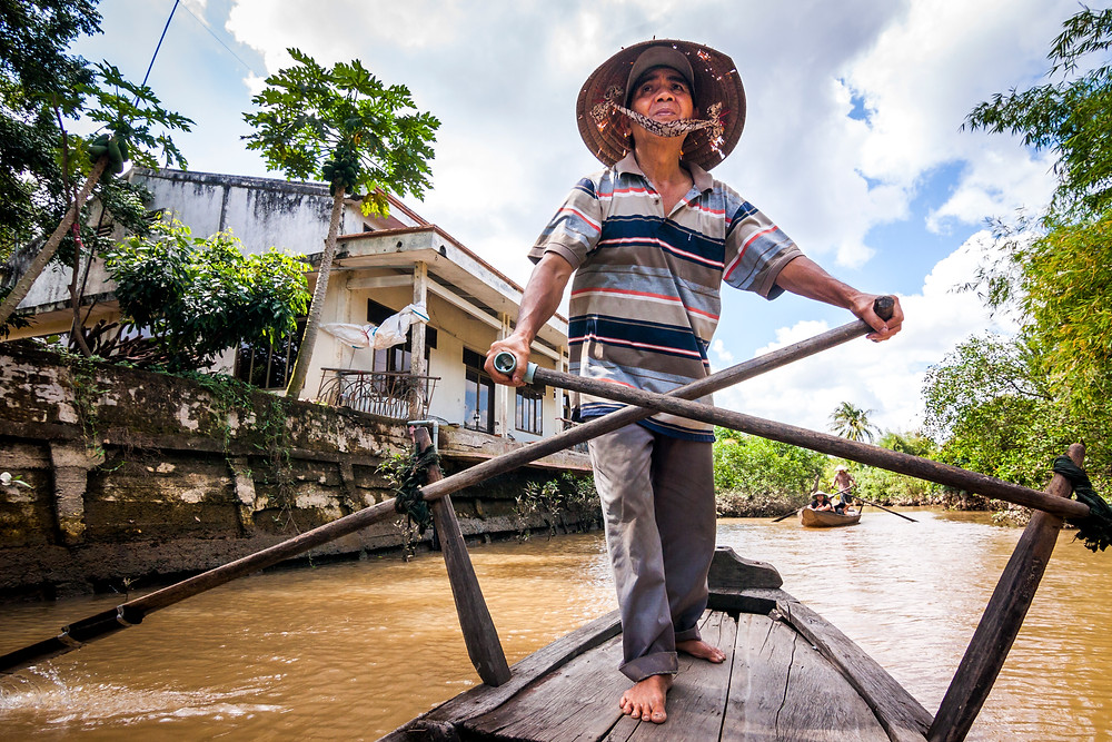 Traditional Rowing Boat on the Mekong Delta River, Vietnam