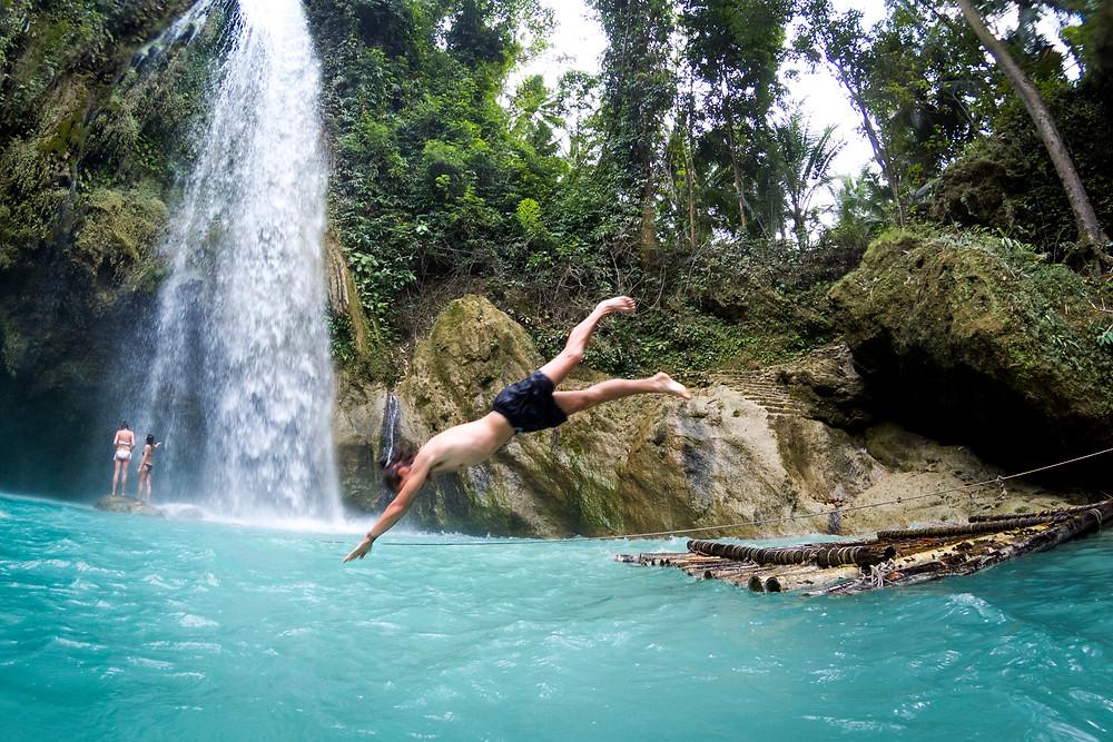 Alex Diving At Inambakan Waterfall, Samboan, Cebu, Philippines