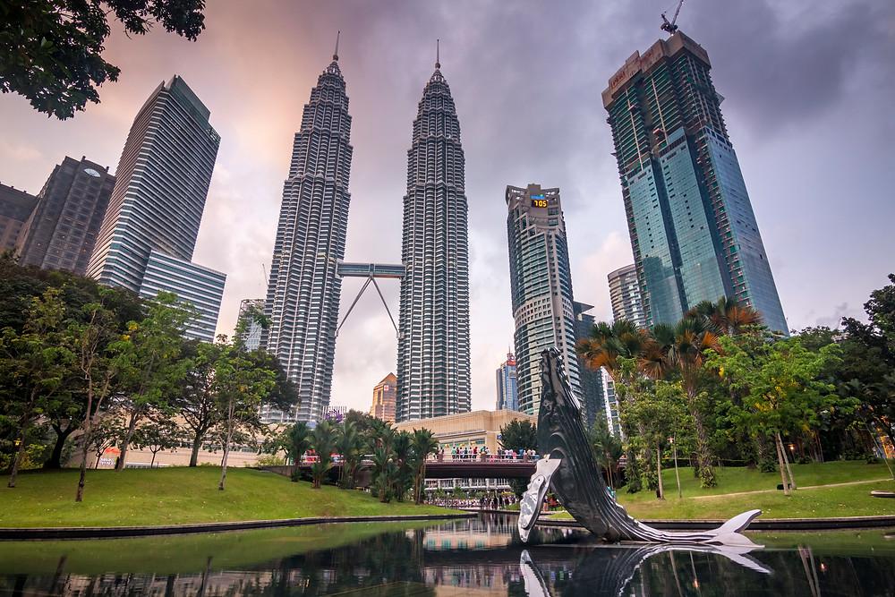Petronas Towers and Symphony Lake, KLCC Park, Kuala Lumpur, Malaysia, Sunset