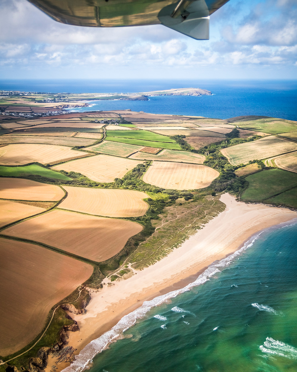 Aerial View Of Tregirls Beach, Cornwall From The Air