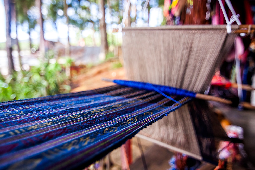 Making Material From Silk at Paradise Lake, Da Lat, Vietnam