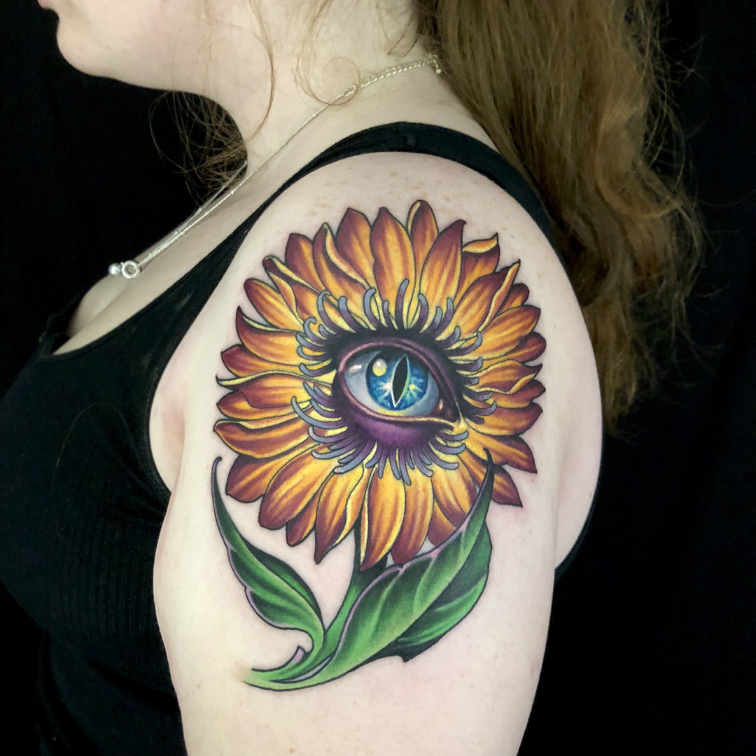 Sun Flower And Eye Ball Tattoo.jpg