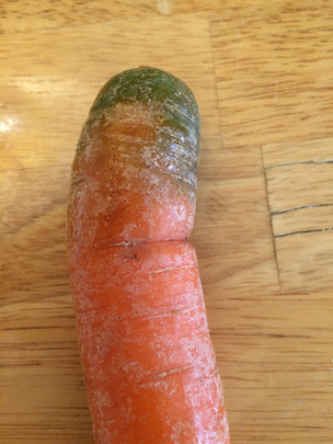 The top of my carrot is green! Can I eat it?