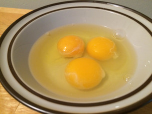 Why are there stringy blobs on my egg yolks?